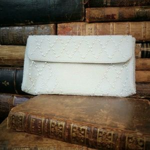 Vintage beaded clutch with faux white pearls.